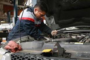 Mechanic Working on Engine